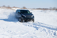 Winter SUV ride Royalty Free Stock Photography