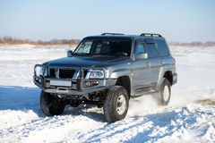 Winter SUV ride Stock Photography