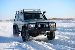 Winter SUV ride Royalty Free Stock Photo