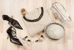 Winter sweater and accessories arranged on the floor. Royalty Free Stock Photos