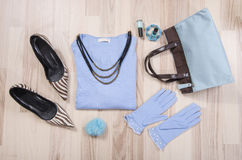 Winter sweater and accessories arranged on the floor. Stock Images