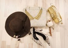 Winter sweater and accessories arranged on the floor. Stock Photography