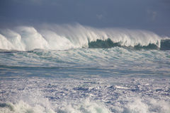 Winter swells. Large wave from winter swells at Hookipa, Maui. Hookipa is a beach on the north shore of Maui, Hawaii, USA Stock Image