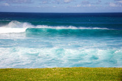 Winter swells. Large wave from winter swells at Hookipa, Maui. Hookipa is a beach on the north shore of Maui, Hawaii, USA Royalty Free Stock Photos