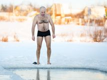 Winter-swimmer  ice-hole at lake Royalty Free Stock Photo