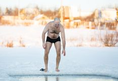 Winter-swimmer  ice-hole at lake Stock Images