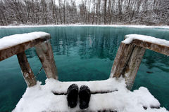 Winter swimming in blue lake Stock Photo
