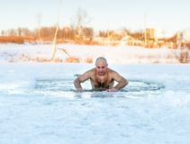 Winter swimming. Man in  ice-hole Stock Image