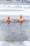 Winter swimming. Man in ice-hole. Winter swimming. Man in an ice-hole in outdoors royalty free stock photo