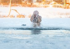 Winter swimming. Man to an ice-hole Stock Photo