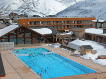 Winter swimming pool. Heated, outdoor swimming pool in the Alpine resort Royalty Free Stock Image