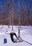 Winter Swing. Swing abandoned to the winter snow Royalty Free Stock Photography