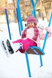 Winter swings for children Royalty Free Stock Photography