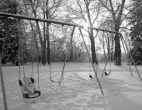 Set of swings in winter snow Royalty Free Stock Photography