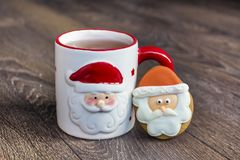 Winter Tea in a Christmas Cup with christmas Cookies Royalty Free Stock Photography