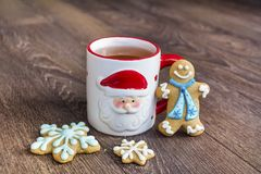 Winter Tea in a Christmas Cup with christmas Cookies Stock Image