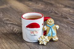 Winter Tea in a Christmas Cup with christmas Cookies Stock Images
