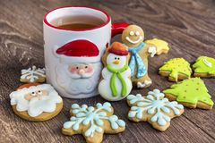 Winter Tea in a Christmas Cup with christmas Cookies Royalty Free Stock Images