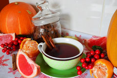 Winter tea with cinamon and tangerines Christmas decorations Royalty Free Stock Images