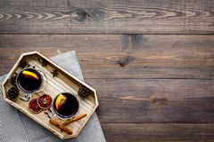 Winter tea with citrus and spices on dark wooden background top view copyspace Stock Images