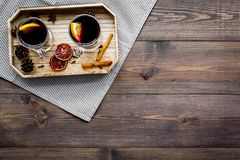 Winter tea with citrus and spices on dark wooden background top view copyspace Stock Image