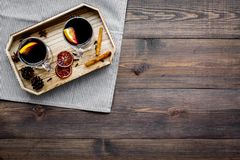 Winter tea with citrus and spices on dark wooden background top view copyspace Stock Photos