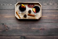 Winter tea with citrus and spices on dark wooden background top view copyspace Royalty Free Stock Photo