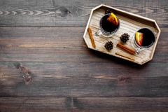 Winter tea with citrus and spices on dark wooden background top view copyspace Royalty Free Stock Image