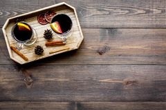Winter tea with citrus and spices on dark wooden background top view copyspace Royalty Free Stock Photography