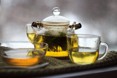 Winter tea. The cozy day in a warm house when the window snow Royalty Free Stock Image