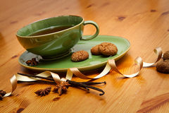 Winter tea. Hot winter tea with ginger cookies and christmas decoration on wooden table Royalty Free Stock Photo
