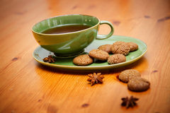 Winter tea. Hot winter tea with ginger cookies on wooden table Royalty Free Stock Photos