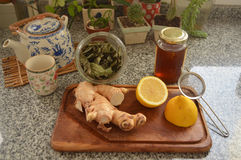 Winter tea ingredients with kitchen items Stock Images