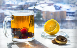 Winter tea with lemon. On linen tablecloths worth a cup of tea with berries and lemon Stock Images