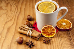 Winter tea with spices on wooden background. Winter tea with spices and oranges on wooden background Royalty Free Stock Photos