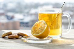 Winter tea. On the tablecloth is worth a cup of tea, lemon and bagels Royalty Free Stock Photos