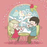 Winter tea time. Girl and Boy chatting and drinking tea Royalty Free Stock Photos