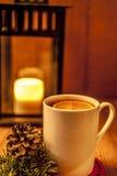 Winter tea on wooden background. Winter tea with branch and cone with candle on wooden background Stock Photography