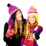 Winter teens. Happy smiling winter hat young women or girls Royalty Free Stock Photo