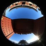 The Temple of Heaven in Beijing, China, under the blue sky and white clouds photographed by fisheye lens. In the winter of 2017, the Temple of Heaven in Beijing royalty free stock image