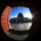The Temple of Heaven in Beijing, China, under the blue sky and white clouds photographed by fisheye lens. In the winter of 2017, the Temple of Heaven in Beijing royalty free stock images