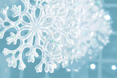 Winter texture with snowflake. Christmas texture snowflake on a blue background Royalty Free Stock Photography