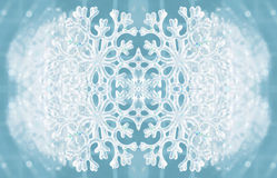 Winter texture with snowflake. Christmas texture snowflake on a blue background Stock Image