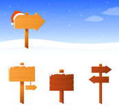Winter theme banner with a wooden sign board. Simple winter theme banner with a wooden sign board and santa hat, plus additional sign boards of different shape Royalty Free Stock Images