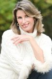 Winter Theme - Gorgeous Woman in White Sweater Royalty Free Stock Image