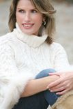 Winter Theme - Gorgeous Woman in White Sweater Royalty Free Stock Photos