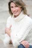 Winter Theme - Gorgeous Woman in White Sweater Royalty Free Stock Photography