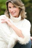 Winter Theme - Gorgeous Woman in White Sweater Royalty Free Stock Images