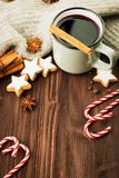 Winter theme. Hot steaming cup of glint wine with spices. Christmas hot steaming cup of glint wine with spices, cinnamon, anise, cookies in a shape of star, red stock photography