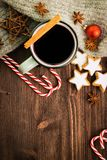 Winter theme. Hot steaming cup of glint wine with spices. Christmas hot steaming cup of glint wine with spices, cinnamon, anise, cookies in a shape of star, red stock photo